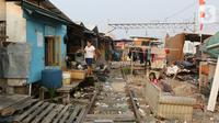 Aktivitas warga di Kampung Muka, Ancol, Jakarta, Selasa (5/11/2019). Pemprov DKI Jakarta mengusulkan anggaran konsultan penataan kampung kumuh sebesar Rp 556 juta per rukun warga (RW) pada rancangan APBD 2020. (Liputan6.com/Herman Zakharia)