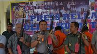 Pembantai orangutan dengan 130 peluru diringkus polisi. Foto: (Abelda Gunawan/Liputan6.com)