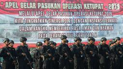 Pasukan Brimob mengikuti apel operasi ketupat 2019 di lapangan Silang Monas, Jakarta, Selasa (28/5/2019).  Apel gelar pasukan operasi ketupat 2019 juga melibatkan personel Satpol PP, 6.913 personel Pramuka, serta 16.076 personel organisasi kemasyarakatan dan kepemudaan. (merdeka.com/Imam Buhori)