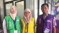 Para penerjemah yang bertugas di Asian Para Games 2018. (Bola.com/Benediktus Gerendo Pradigdo)