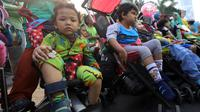 Sejumlah anak penyandang Cerebral Palsy mengikuti kampanye untuk memperingati Hari Cerebral Palsy Sedunia di kawasan Car Free Day, Jakarta, Minggu (13/10/2019). Kegiatan tersebut dilakukan untuk memperingati Hari Cerebral Palsy Sedunia yang jatuh pada tanggal 6 Oktober. (Liputan6.com/Johan Tallo)