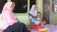 Bocah penderita Hidrosefalus sedang digendong ibunya (Liputan6.com/Mohamad Fahrul).