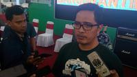 Juru bicara KPK, Febri Diansyah berharap Presiden Jokowi menunjukkan komitmennya dalam pemberantasan korupsi dengan tidak menyetujui revisi UU KPK (Liputan6.com/Zainul Arifin)