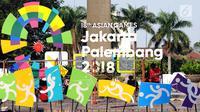 Pekerja menyelesaikan pemasangan logo Asian Games 2018 di kawasan Bundaran Hotel Indonesia, Jakarta, Rabu (16/8). Jelang peluncuran hitung mundur Asian Games 2018 pemasangan karakter cabang olahraga dipercepat. (Liputan6.com/Helmi Fithriansyah)