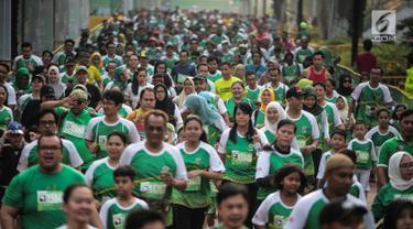 Ribuan peserta mengikuti lomba lari Milo Jakarta International 10K di kawasan Rasuna Epicentrum, Jakarta, Minggu (14/7/2019). Lomba ini digelar sebagai bagian dari perayaan Hari Ulang Tahun (HUT)  ke-492 DKI Jakarta. (Liputan6.com/Faizal Fanani)