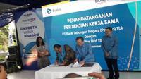 Penandatanganan perjanjian kerja sama BTN dan PT Blue Bird Tbk (Foto:Liputan6.com/Bawono Y)