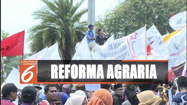 Petani, mahasiswa, dan buruh, berunjuk rasa kritik pemerintah dalam selesaikan persoalan reforma agraria.
