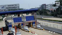 Pengendara memasuki gerbang tol Margonda II, Depok, Jawa Barat, Selasa (4/6/2019). Pembukaan ruas tol Cijago Seksi II secara fungsional tersebut dimulai 3 Juni 2019 pukul 14.00 WIB hingga 10 Juni 2019 pukul 14.00 WIB. (Liputan6.com/Helmi Fithriansyah)
