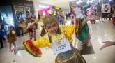 Penari berkostum tradisional Indonesia menari dalam perhelatan Indonesia Menari 2019 di Grand Indonesia, Jakarta, Minggu (17/11/2019). Indonesia Menari 2019 digelar secara serentak di tujuh kota besar dengan melibatkan sekitar 7.000 penari (Liputan6.com/Faizal Fanani)