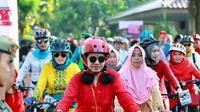 Bersepeda pagi hari (Liputan6.com/Dian Kurniawan)