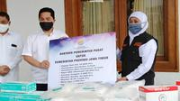 Penyerahan bantuan pemerintah untuk pemerinta provinsi Jawa Timur (Foto: Liputan6.com/Dian Kurniawan)