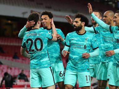 Kedua tim bermain imbang tanpa gol pada babak pertama. Namun, Liverpool mampu mencetak tiga gol pada babak kedua melalui Diogo Jota (dua gol) dan Mohamed Salah. (Foto: AFP/Pool/Catherine Ivill)