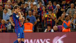 Ekspresi pemain Barcelona, Ivan Rakitic, setelah mencetak gol ke gawang Atletico Madrid dalam laga pekan kelima La Liga Spanyol musim ini yang berlangsung di Camp Nou, Kamis (22/9/2016) dini hari WIB. (Reuters/Albert Gea)