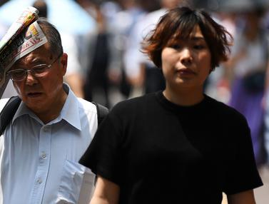 Potret Warga Tokyo Kepanasan Saat Cuaca Ekstrem