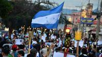 Aksi prote smenentang pemerintahan Honduras terus berlangsung selama pertengahan Juni 2019 (AFP/Orlando Sierra)