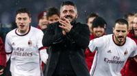 Pelatih AC Milan Gennaro Gattuso merayakan kemenangan tim asuhannya atas Lazio pada laga leg kedua semifinal Coppa Italia di Stadio Olimpico, Rabu (28/2). Milan memastikan tiket final setelah melalui drama adu penalti 5-4. (Ettore Ferrari/ANSA via AP)