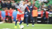 Striker tim nasional Inggris, Wayne Rooney. (AFP/Jeff Pachoud)