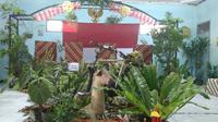 (TPS) 14, RW 05 Lio Genteng, Kelurahan Nyengseret, Kecamatan Astana Anyar, Kota Bandung, mengangkat tema selamatkan hutan.