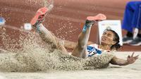 Pelompat jauh putri Indonesia, Maria Londa, saat beraksi pada Asian Games di SUGBK, Jakarta, Senin (27/8/2018). Hanya finis di peringkat kelima, Maria Londa gagal mempersembahkan medali. (Bola.com/Peksi Cahyo)