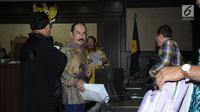 Terdakwa perkara merintangi penyidikan KPK pada kasus korupsi e-KTP, Fredrich Yunadi saat mengikuti sidang lanjutan di Pengadilan Tipikor, Jakarta, Kamis (31/5). Sidang mendengar tuntutan JPU KPK. (Liputan6.com/Helmi Fithriansyah)
