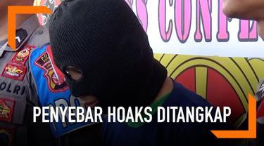 Polres Kuningan menangkap seorang pria di Cilacap yang diduga menyebarkan video hoaks di media sosial. Kabar bohong yang disebarkan menyebut polisi menyamar mengangkut formulir C1.