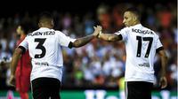 GOL CEPAT - Rodrigo membawa Valencia unggul 1-0 di menit keempat saat menghadapi AS Monaco. (AFP)