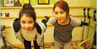 IU dan Yoo In Na memang menjalin persahabatan yang sangat dekat. Bahkan IU menyebut jika Yoo In Na merupakan sumber inspirasinya. (Foto: Soompi.com)