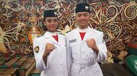 Paskibraka asal Kalimanten Timur Ferina Julia Syarif dan Alfares Deo Simangunsong. (Liputan6.com/Aditya Eka Prawira)