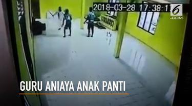 Seorang guru tega memukul seorang anak di panti asuhan secara membabi buta dengan menggunakan kayu bulat.