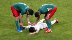 Dalam pertandingan yang berlangsung di Stadion Saitama, tuan rumah Jepang harus mengakui keunggulan Meksiko dengan skor 1-3. (Foto: AP/Gregorio Borgia)