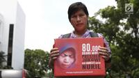 Penggagas petisi Koalisi Save Ibu Nuril mendatangi Kantor Staf Presiden (KSP) di Jakarta, Senin (19/11). Kedatangan mereka untuk menyerahkan permohonan pemberian amnesti untuk Baiq Nuril. (Liputan6.com/Herman Zakharia)