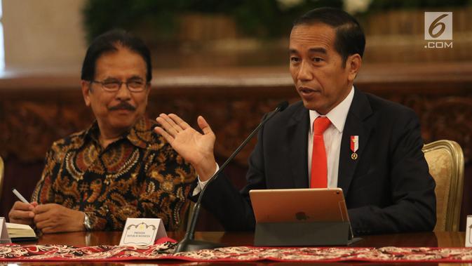 Presiden Jokowi didampingi Menteri ATR/BPN Sofyan Djalil memberikan keterangan pers rencana pemindahan Ibu Kota Negara di Istana Negara, Senin (26/8/2019). Lokasi Ibu Kota berada di wilayah Kabupaten Pejaman Penajam Pasar utara dan Kabupaten Kutai Kartanegara di Kaltim. (Liputan6 com/Angga Yuniar)