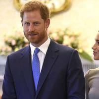 Meghan Markle dan Pangeran Harry (AP Photo)