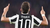 Pemain Juventus, Paulo Dybala merayakan gol ke gawang AC Milan pada laga Serie A di Allianz Stadium, Turin, (31/3/2018). Juventus menang 3-1. (Alessandro Di Marco/ANSA via AP)