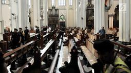 Tim Gegana dan K9 Polda Metro Jaya melakukan penyisiran jelang Misa Natal di Gereja Katedral, Jakarta, Senin (24/12). Misa malam Natal di Gereja Katedral Jakarta akan dilangsungkan dalam tiga waktu. (Merdeka.com/Iqbal Nugroho)