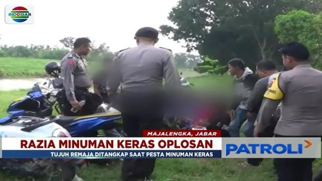 Polsek Jatitujuh dan TNI tangkap tujuh remaja yang asyik berpesta miras oplosan di Majalengka, Jawa Barat.