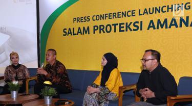 Chief Sharia Business Sun Life Norman Nugraha memberi keterangan pers pada peluncuran Salam Proteksi Amanah, di Jakarta, Kamis (16/5). PT Sun Life Indonesia berkolaborasi dengan Dompet Dhuafa menghadirkan dua pilihan baru dalam berdonasi melalui kontribusi asuransi. (Liputan6.com/HO/Bon)