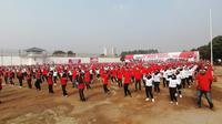 Sekitar 1.500 warga binaan pemasyarakatan (WBP) menari kolosal di Lapas Kelas I Tangerang, Banten, Kamis (15/9/2019). (Liputan6.com/Pramita Tristiawati)