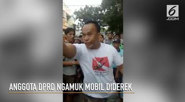 Anggota DPRD DKI Jakarta, Fajar Sidiq, marah saat mobilnya diderek Dishub.