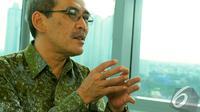 Ketua Tim Reformasi Tata Kelola Minyak dan Gas Bumi, Faisal Basri, menjelaskan status Pertamina Trading Energy Limited (Petral) saat berkunjung ke Liputan6.com, Jakarta, Selasa (6/1/2015). (Liputan6.com/Faisal R Syam)