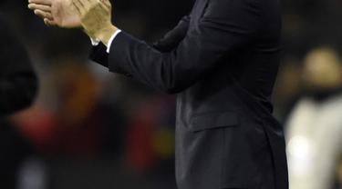 Pelatih Los Blancos, Santiago Solari puas dengan penampilan anak asuh nya saat melawan Celta Vigo pada laga lanjutan pekan ke-12 La Liga 2018/19, Senin (12/11) yang berlangsung di stadion Balaidos, Spanyol. Real Madrid menang 4-2. (AFP/Miguel Riopa)