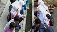 Sekolah di Ipoh, Perak, Malaysia, budi dayakan ikan di selokan sekolah. (dok. GPS Bestari)
