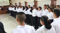Peserta Diklat Paskibraka Nasional 2018 saat upacara peresmian di Wisma Soegondo Cibubur, Jakarta, Kamis (26/7). Diklat diikuti 68 siswa terbaik dari 34 provinsi di Indonesia. (Liputan6.com/Helmi Fithriansyah)