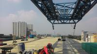 Pembangunan jalan Tol Bogor Outer Ring Road (BORR) sesi IIB - sepanjang 2,65 kilometer (KM) terus dikebut. (Liputan6.com/Achmad Sudarno)