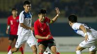 Son Heung-min saat duel kontra Kirgizstan di Stadion Si Jalak Harupat, Soreang, Bandung, pada laga terakhir penyisihan Grup E Asian Games 2018, Senin 920/8/2018). (Bola.com/Dok. INASGOC)