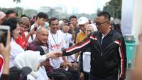 Menpora Imam Nahrawi mewakili Presiden RI melepas peserta Funwalk Bersama Kaum Difabel, di Area Car Freeday FX Sudirman, Jakarta, Minggu (8/9).