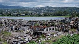 Pemandangan kehancuran bangunan-bangunan di Kota Marawi, Provinsi Lanao del Sur, Filipina, Kamis (23/5/2019). Rumah, masjid, gereja, dan bangunan lainnya hancur porak poranda dalam pertempuran antara pasukan pemerintah dengan militan ISIS yang berlangsung selama lima bulan. (Noel CELIS/AFP)
