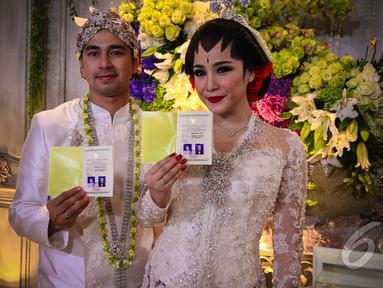 Jumat (17/10/14), Raffi Ahmad dan Nagita Slavina sah menjadi pasangan suami-istri, Jakarta. (Liputan6.com/Faizal Fanani)