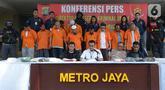 Wadir Reskrimum Polda Metro Jaya AKBP Dedy Murti Haryadi menyampaikan keterangan pers saat rilis kasus penganiayaan terhadap pegiat media sosial Ninoy Karundeng di Jakarta, Selasa (22/10/2019). Polisi menetapkan 15 tersangka dalam kasus penganiayaan terhadap Ninoy Karundeng. (merdeka.com/Imam Buhori
