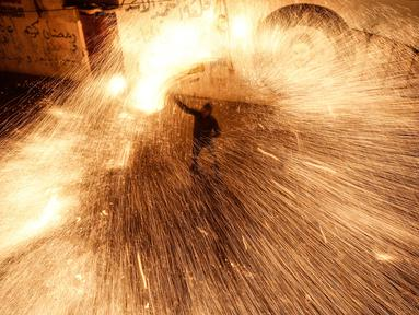 Permainan ini sedianya dilakukan menyambut setiap bulan suci Ramadhan.(MAHMUD HAMS / AFP)